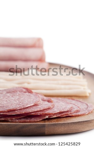 Portrait image of meat and ham rolls against white background