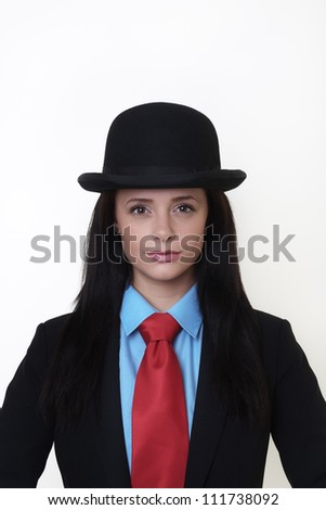 portrait image of sexy woman wearing a suit with bowler hat based around the painting of Rene Magritte