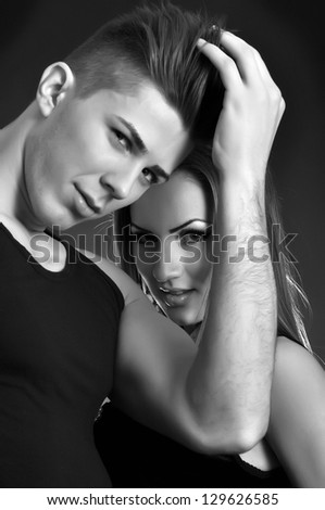 Portrait in black and white of a young couple in love