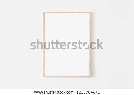 Portrait large 50x70, 20x28, a3,a4, Wooden frame mockup on white wall. Poster mockup. Clean, modern, minimal frame. Empty fra.me Indoor interior, show text or product