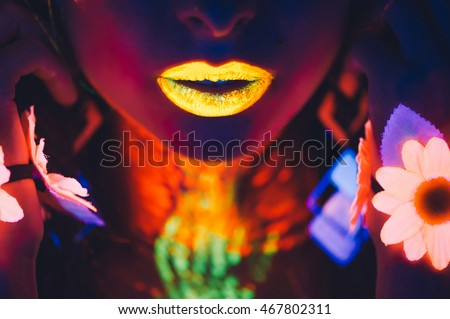 Stock Photo portrait, lips and hands in the neon light, glowing flowers