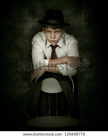 Portrait looking danger young man in gangster retro style - stock photo