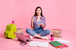 Portrait lovely lady teen teenager sit have thought thoughtful imagine guess computer laptop use user question isolated checked shirt trendy stylish jeans denim pink background