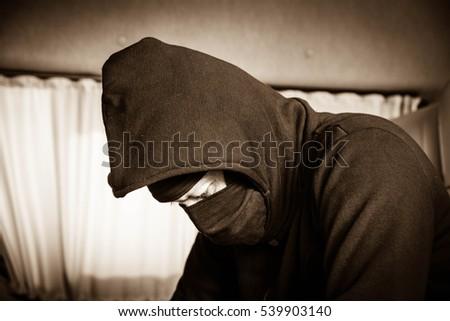 Portrait man in black mask evil criminal,Dangerous man ,Crime concept