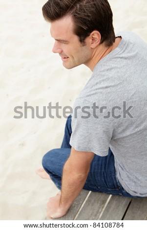 Portrait man sitting by beach