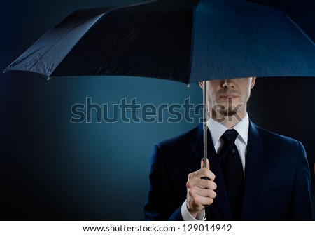portrait  man the  beautiful  man in blue costume with umbrella,  special-service agent