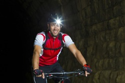Portrait Mountainbiker with headlamp