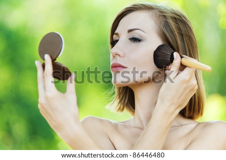 portrait naked brown-haired woman square looks mirror powder