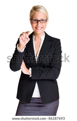 Portrait od friendly attractive blond business woman pointing at the camera isolated on white background.