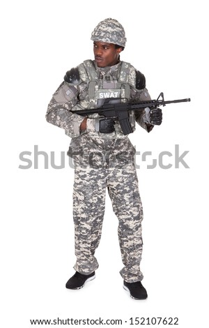 Portrait Of A African Soldier With Gun Isolated Over White Background