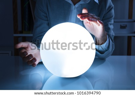Portrait Of A Afro American Businesswoman Hand On Crystal Ball In Office #1016394790