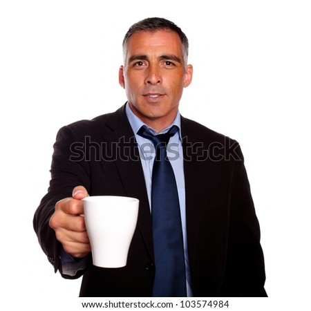 Portrait of a attractive executive with a white mug asking you for fill it against white background