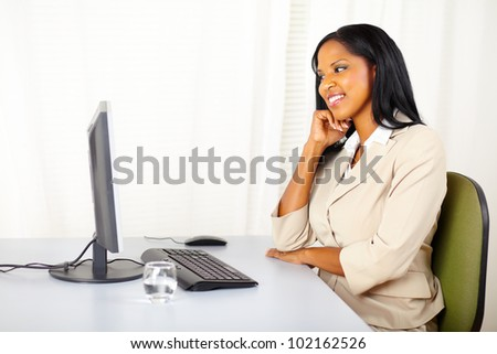 Portrait of a attractive executive woman looking the computer screen