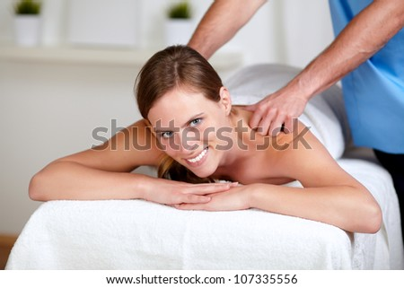 Portrait of a attractive woman receiving a body massage at a spa resort
