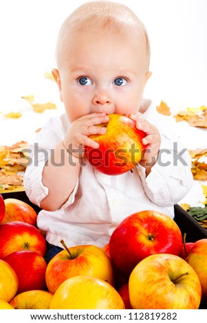 Portrait of a baby eating apple