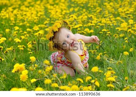 Portrait of a baby in a dandelion wreath