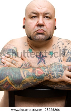 portrait of a bald man with tattoos