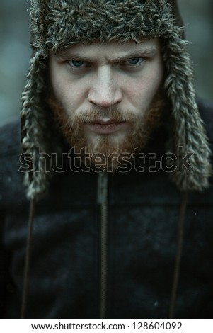 Portrait of a bearded man in a cap