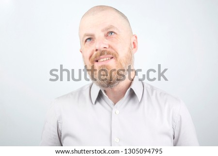 portrait of a bearded man on a light background #1305094795