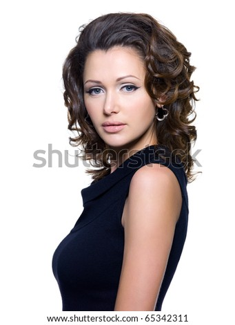 Portrait of a beautiful adult sexy woman with curly hair. Model posing over white background