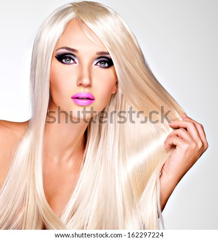 Portrait of  a  beautiful adult woman with long white straight  hairs.  Face of a Fashion model with pink lipstick. Pretty girl posing at studio.
