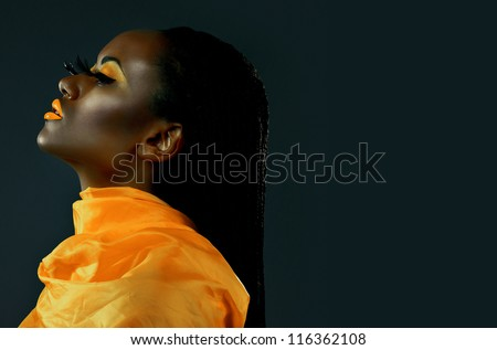 Portrait of a beautiful African girl with creative make-up in profile