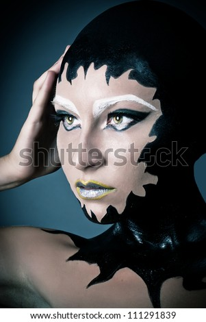 Portrait of a beautiful alien lady with original dark make up