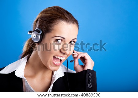 Portrait of a beautiful and young businesswoman with headsets and laughing