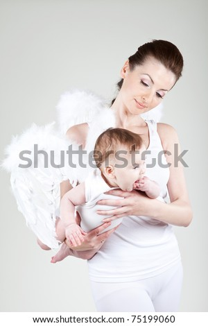Portrait of a beautiful angelic woman with a child