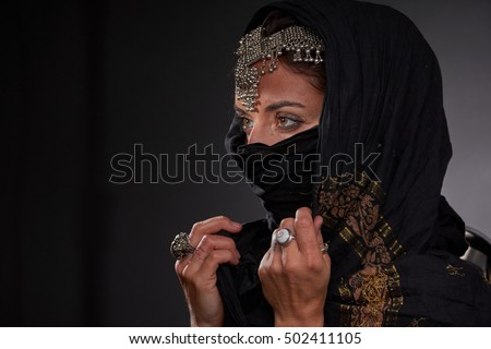 portrait of a beautiful Arab girl for advertising and magazines. Photos in the style of noir