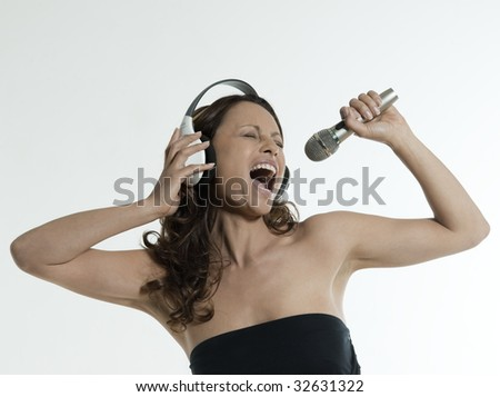 portrait of a beautiful asian woman on isolated white background singin