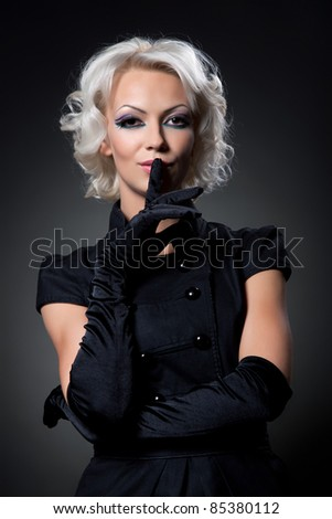 Portrait of a beautiful attractive woman with make up and hair style over black background, series of photos