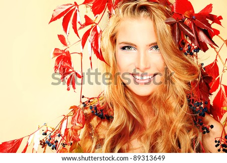 Portrait of a beautiful autumn woman.