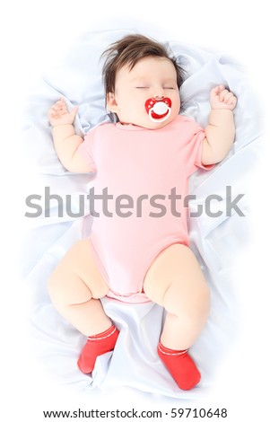 Portrait of a beautiful baby sleeping on a white towel.