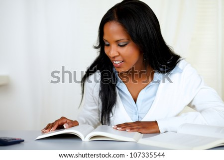 Portrait of a beautiful black girl studying at soft colors composition