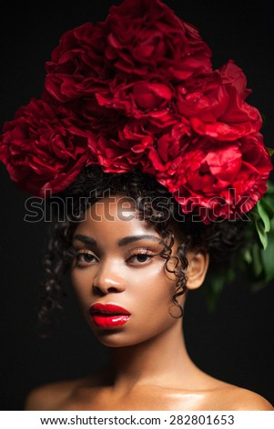 Portrait Of A Beautiful Black Woman With Flowers On Her Head