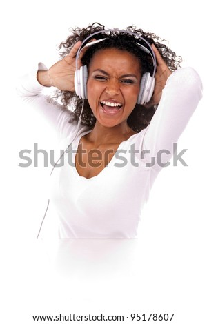 Portrait of a beautiful black woman with headphones listening to music in the studio