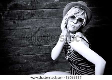 portrait of a beautiful blond girl with hat