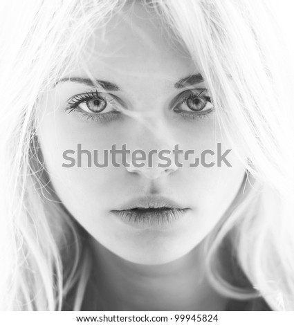 Portrait of a beautiful blonde closeup. Black and white photo