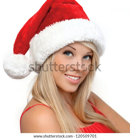portrait of a beautiful blonde girl in a red Christmas hat for the new year