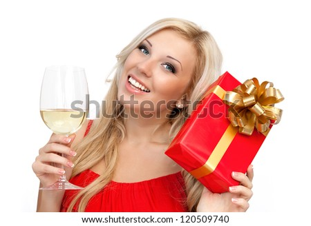 portrait of a beautiful blonde girl in a red dress with a glass of wine and a gift for the holiday
