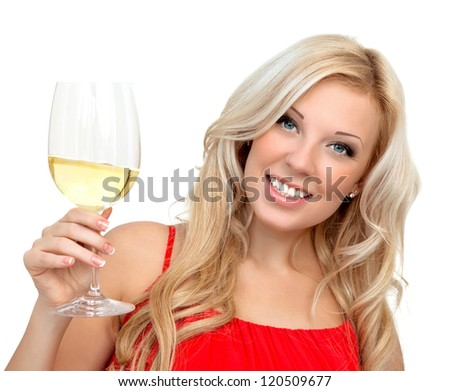 portrait of a beautiful blonde girl in a red dress with a glass of wine for the holiday