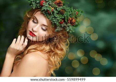 Portrait of a beautiful blonde girl with fir wreath on his head. Magic. Christmas