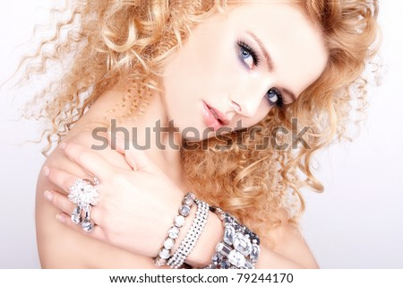Stock Photo portrait of a beautiful blonde girl with luxury accessories isolated on white background