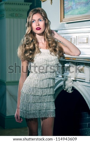 portrait of a beautiful blonde in the antique interior