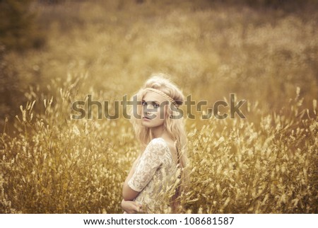 portrait of a beautiful blonde in the field