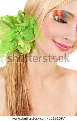 Portrait of a beautiful blonde woman with fashionable colorful make-up isolated on white background