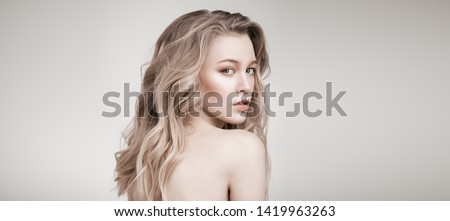 Portrait of a beautiful blonde woman with natural make-up. Beauty, haircare, cosmetics concept. Healthcare. White background.