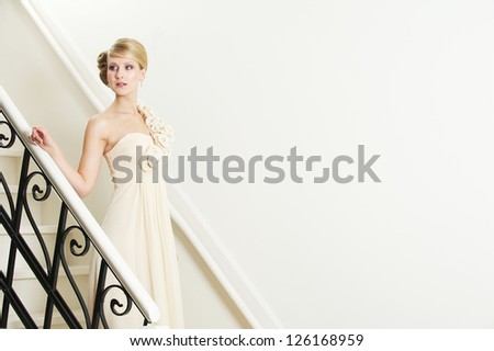 Portrait of a beautiful bride walking down the stairs