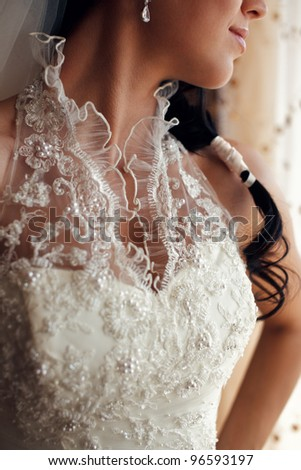 Portrait of a beautiful brides low-necked dress